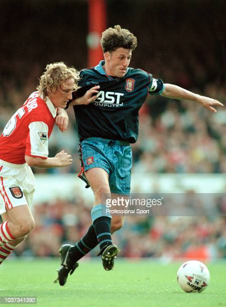 Andy Townsend of Aston Villa is challenged by Ray Parlour of Arsenal during an FA Carling Premiership match at Highbury on October 21, 1995 in...