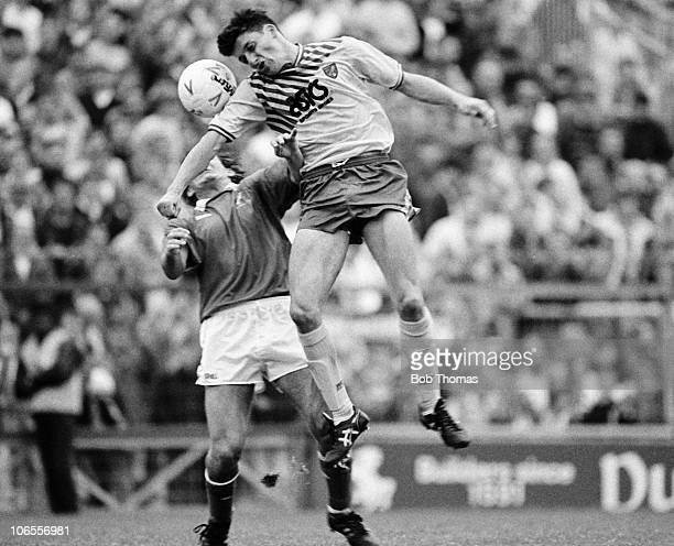 Andy Townsend of Norwich City heads the ball in front of Terry Hurlock of Millwall during the Millwall v Norwich City Division 1 match played at The...