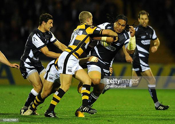 Andy Tuilagi of Sale Sharks is tackled by Joe Simpson of London Wasps during the AVIVA Premiership match between Sale Sharks and London Wasps at...