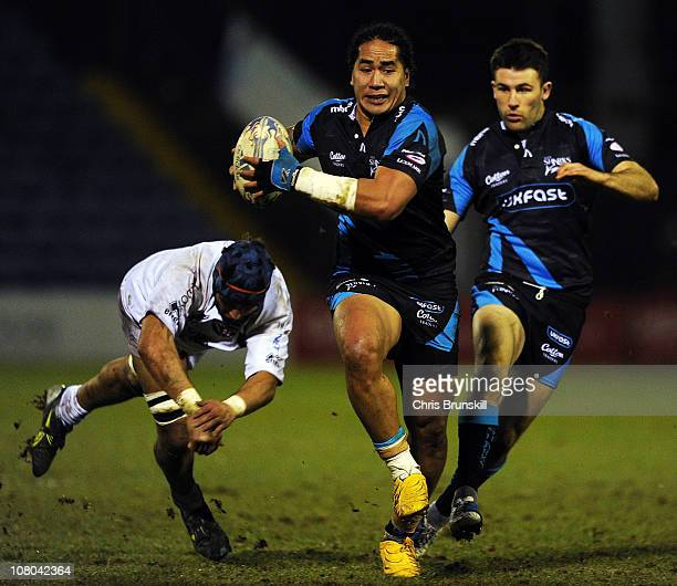 Andy Tuilagi of Sale Sharks races away from Dion Kingi of Petrarca Rugby during the Amlin Challenge Cup match between Sale Sharks and Petrarca Rugby...