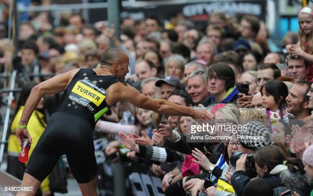 Andy Turner meets the fans after the Men's 200m Hurdle event during the Great CityGames on Deansgate Manchester