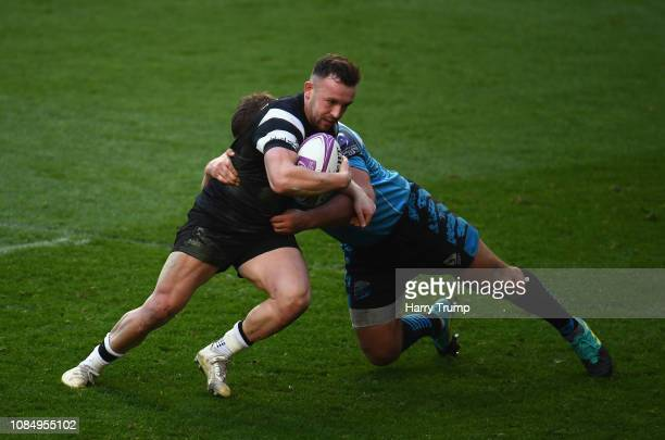 Andy Uren of Bristol Bears is tackled by Andrei Polivalov of Enisei STM during the Challenge Cup match between Bristol Bears and Enisei-STM at Ashton...