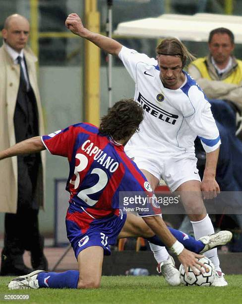 Andy Van Der Meyde of Inter is challenged by Ciro Capuano of Bolognaduring the Serie A match between Bolgona and Inter Milan at the Renato Dall'Ara...