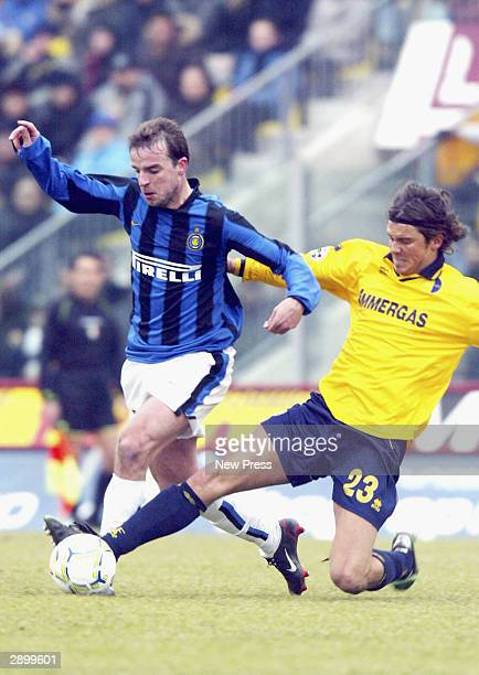Andy van der Meyde of Inter is tackled by Simone Pavan of Modena during the Serie A match between Modena and Inter Milan played at the Alberto...