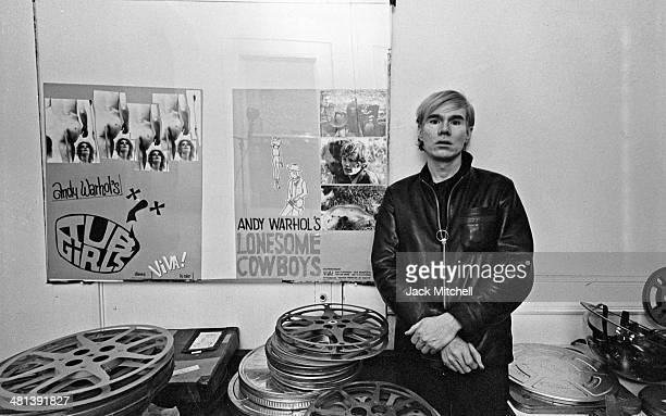 Andy Warhol at the Factory with posters for Tub Girls and Lonesome Cowboys .