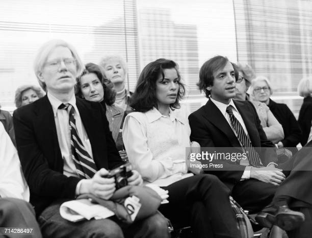 Andy Warhol Bianca Jagger and Steve Rubell attend a Halston fashion show circa 1978 in New York City