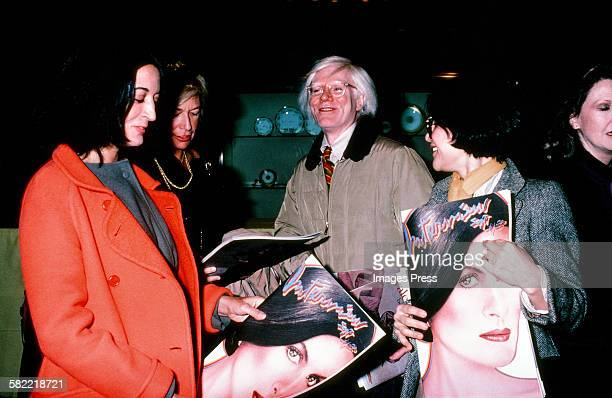 Andy Warhol celebrates Interview Magazines' Paloma Picasso cover circa 1980 in New York City.