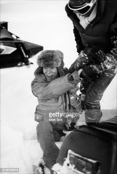 Andy Warhol covered in snow after a snowmobile crash with Jon Gould documented in 'The Andy Warhol Diaries' on new year's day January 1 1983 in Aspen...