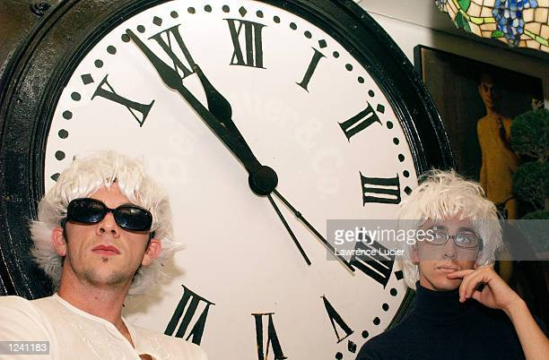 Andy Warhol fans Kyle Lang and Henry Alberto appear at a lookalike contest and seance at the restaurant Serendipity August 2 2002 in New York City...