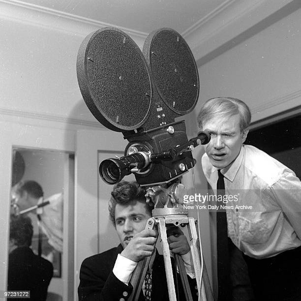 Andy Warhol has things in focus as he's ready to shoot assisted by friend Gerard Malanga