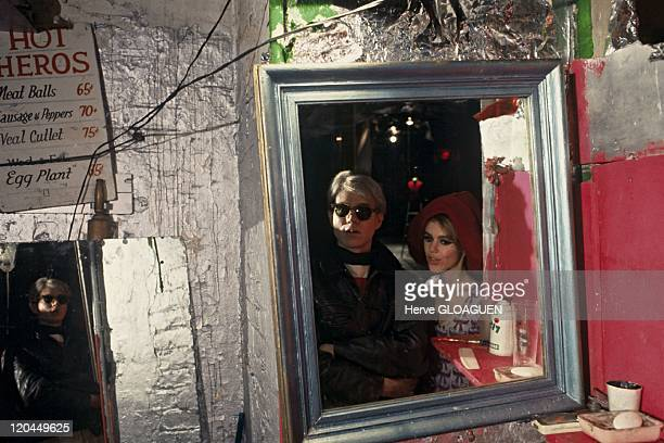 Andy Warhol in New York United States in 1966 Andy Warhol and Edie Sedgwick at the Factory this actress made a part of the Factory's band and shot in...