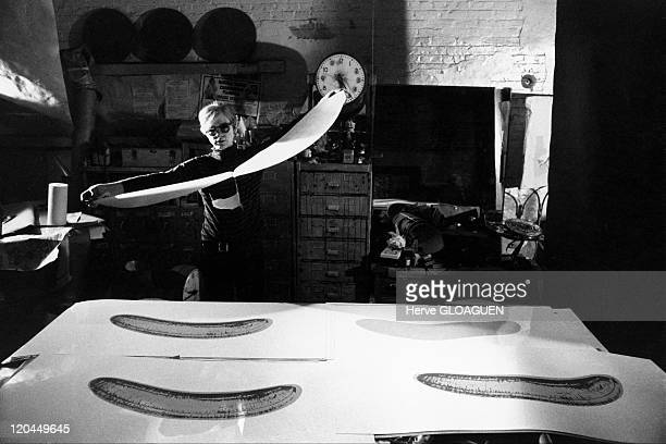 Andy Warhol in New York United States in 1966 Andy Warhol at the Factory get ready to do a collage with form of a banana
