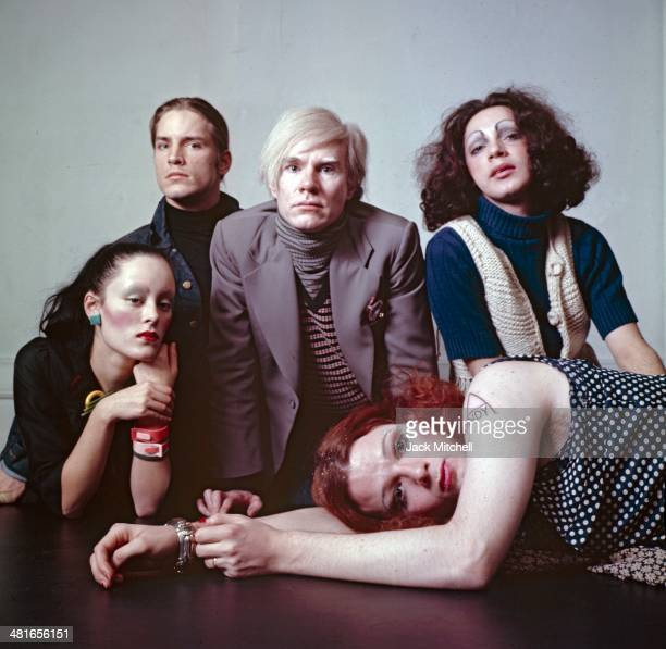 Andy Warhol photographed at the Factory with superstars Jane Forth, Jackie Curtis, Joe Dallesandro, and Holly Woodlawn.