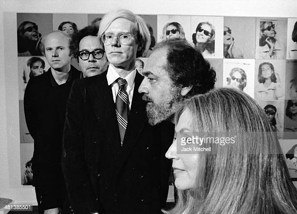Andy Warhol photographed with art collectors Ethel and Robert Scull sculptor George Segal and painter James Rosenquist at the Scull's residence in...
