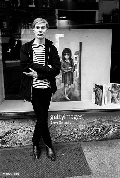 Andy Warhol Poses as Keane Painting