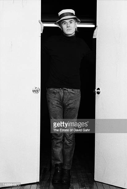 Andy Warhol poses for a portrait to publicize Warhol's 1968 book 'a' in December 1968 at The Factory at 33 Union Square West in New York City New York