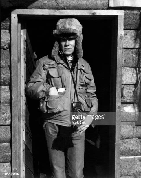Andy Warhol stands in a mountain cabin door on new year's day January 1 1983 in Aspen Colorado