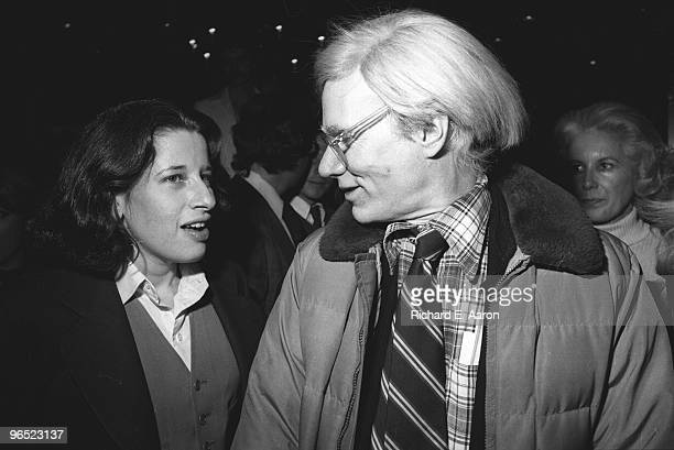 Andy Warhol talks to Fran Lebowitz at a party in New York in 1977