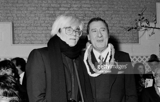 Andy Warhol with italian actor Alberto Sordi posing for a photo on December 31 1986 in New York New York