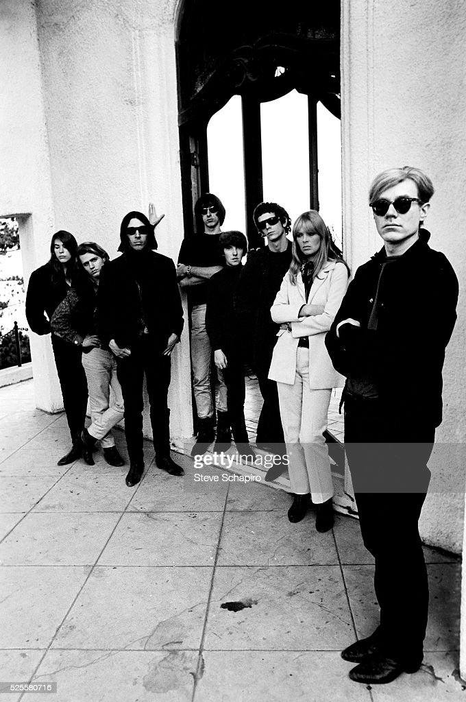 Andy Warhol with (R - L) Mary Woronov, Gerard Malanga, John Cale, Sterling Morrison, Maureen Tucker, Lou Reed and Nico at Phillip Law's home during the Exploding Plastic Inevitable tour.