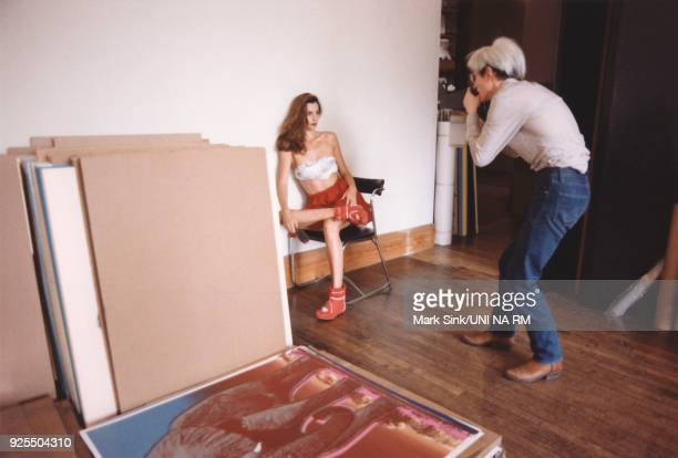 Andy Warhol works at The Factory with his Polaroid Big Shot Camera The instant images are used to make his silkscreen portraits The subject is...