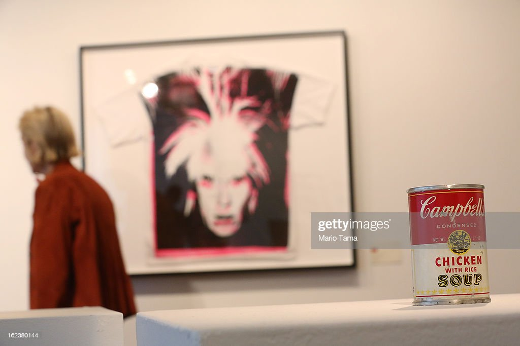 Andy Warhol's 'Campbell's Chicken with Rice Soup' (R) stands at a press preview for the Andy Warhol @ Christie's online-only sale on February 22, 2013 in New York City. The sale will be the first ever online-only sale of Warhol's work with 125 pieces and runs February 26 to March 5.
