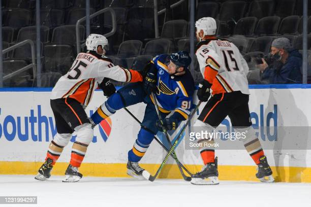 Andy Welinski of the Anaheim Ducks and Ryan Getzlaf of the Anaheim Ducks defend against Vladimir Tarasenko of the St. Louis Blues on March 28, 2021...