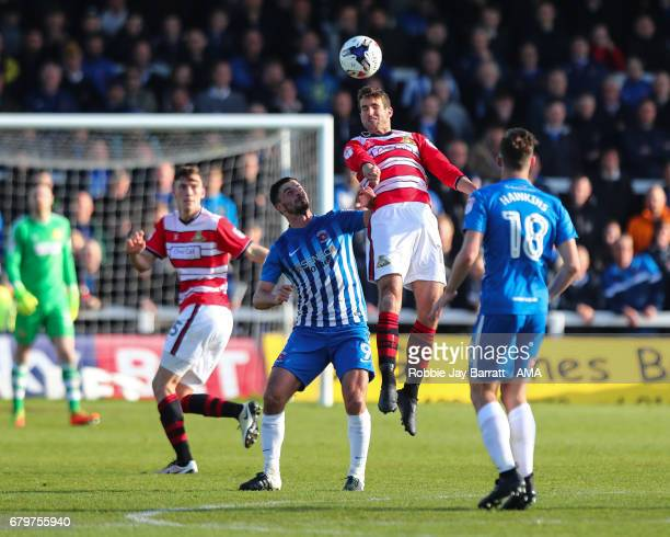 Andy Williams of Doncaster Rovers and Padraig Amond of Hartlepool United during the Sky Bet League Two match between Hartlepool United and Doncaster...