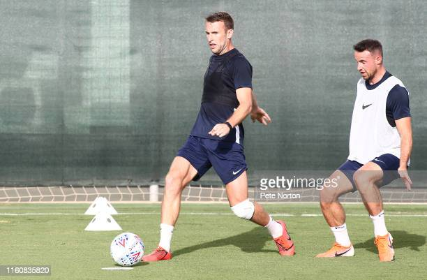Andy Williams of Northampton Town plays the ball watched by Matthew Warburton during a training session at Pinatar Arena on July 08 2019 in Murcia...