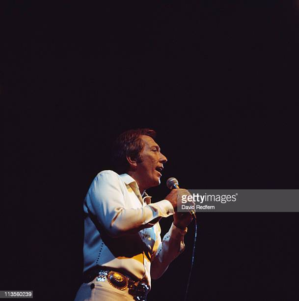 Andy Williams US singer singing into a microphone during a live concert performance at the Royal Albert Hall in London England Great Britain in April...