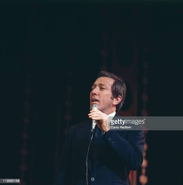 Andy Williams US singer singing into a microphone during a live concert performance circa 1965
