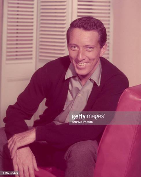 Andy Williams US singer smiling while sitting in an armchair circa 1965