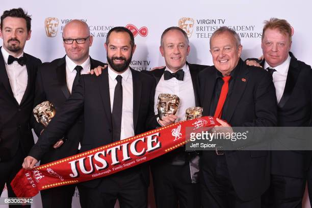 Andy Worboys Nicholas Bennett Daniel Gordon Andy Boag Phil Scraton Tim Atack and John Battsek pose with the award for Single Documentary in the...