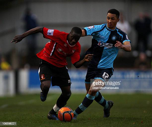 Andy Yiadom of Hayes Yeading battles with Lewis Montrose of Wycombe during the Hayes and Yeading United FC and Wycombe Wanderers FA Cup 1st Round...