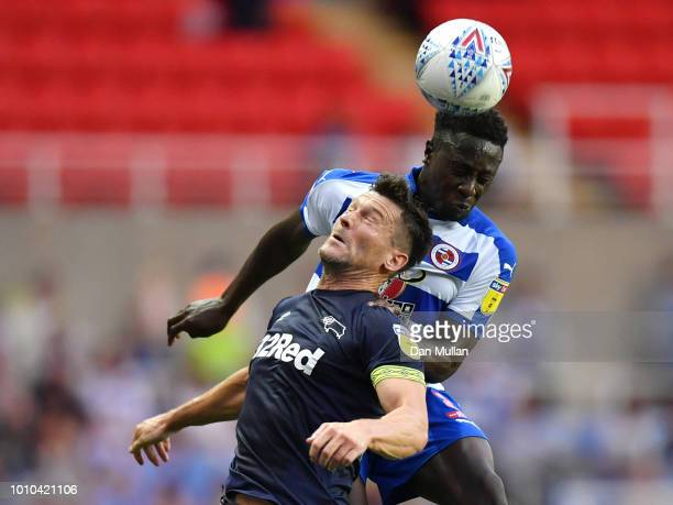 Andy Yiadom of Reading competes for a header with David Nugent of Derby County during the Sky Bet Championship match between Reading and Derby County...