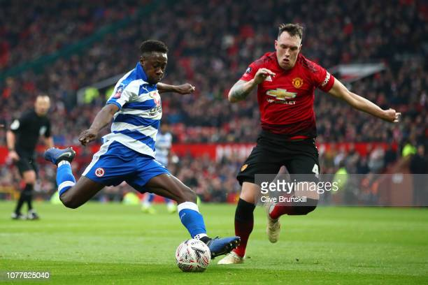 Andy Yiadom of Reading shoots while under pressure from Phil Jones of Manchester United during the FA Cup Third Round match between Manchester United...