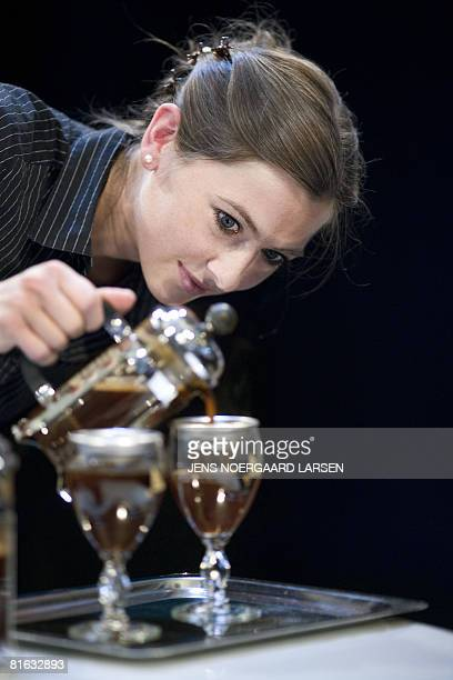 Ane Cecilie Braaten from Norway concentrates as she is in the process of making Irish coffee at the World Barista Coffee Championships in Copenhagen...