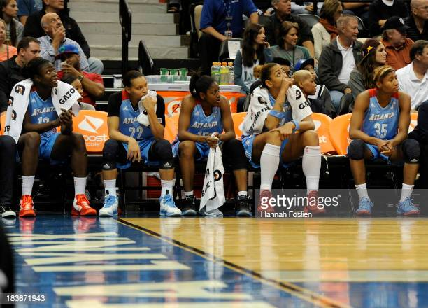 Aneika Henry Armintie Herrington Tiffany Hayes Erika de Souza and Angel McCoughtry of the Atlanta Dream look on against the Minnesota Lynx during the...