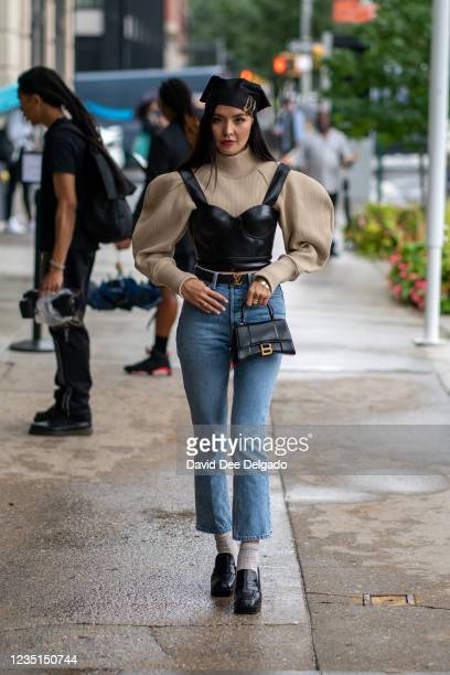 Aneka Itimova is seen wearing a top and jeans by GRLFRND, belt by Louis Vuitton, hand bag by Balenciaga and shoes by Jonak while arriving the Duo...