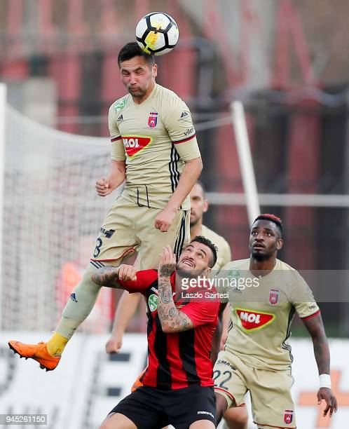 Anel Hadzic of Videoton FC battles for the ball in the air with Davide Lanzafame of Budapest Honved in front of Ianique dos Santos Tavares 'Stopira'...