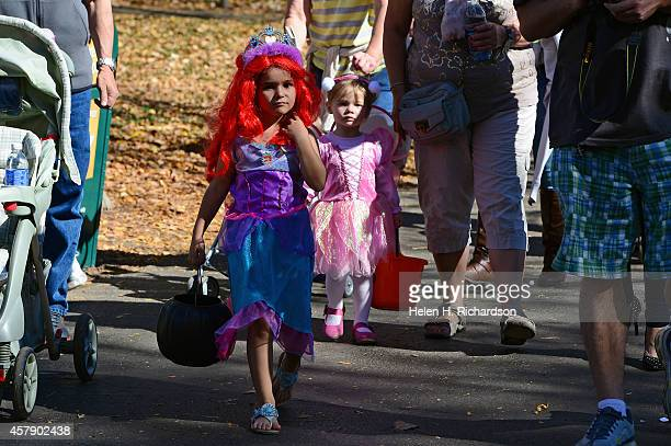 Anelia Tsedov and her friend Sophia Hristova 2 in back walk to a trick or treat station at the 30th annual Boo at the Zoo halloween event that...