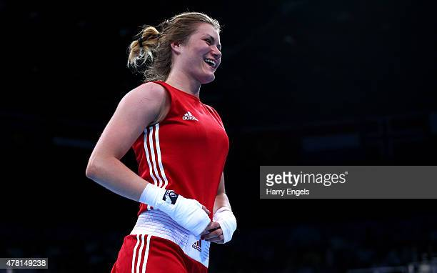 Aneta Rygielska of Poland celebrates victory over Anais Kistler of Switzerland in the Women's Boxing Light Welterweight Quarter Final during day...
