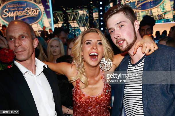 Aneta Sablik celebrates with her partner Kevin and father after winning the final of 'Deutschland sucht den Superstar' show at Coloneum on May 3 2014...