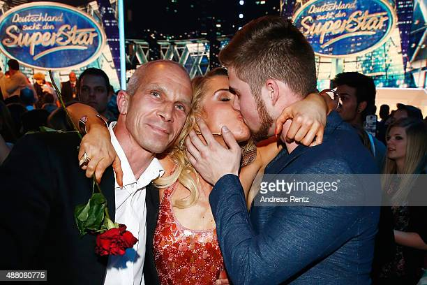 Aneta Sablik kisses her partner Kevin as her father smiles after winning the final of 'Deutschland sucht den Superstar' show at Coloneum on May 3...