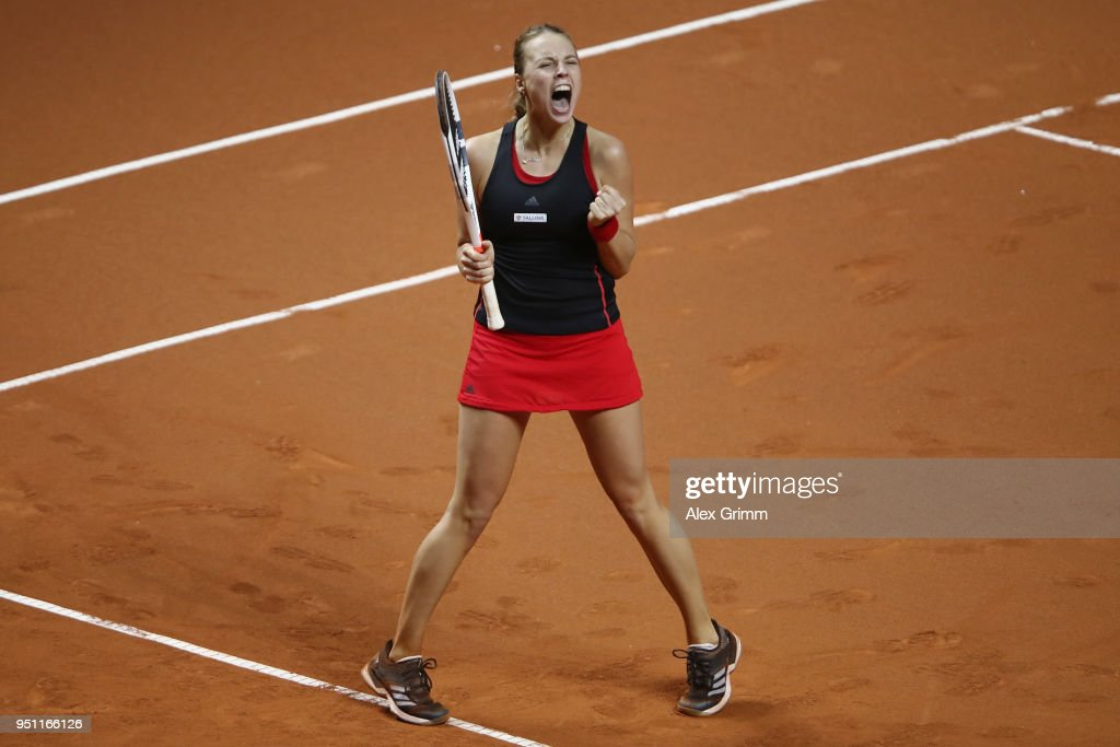 Anett Kontaveit of Estonia celebrates after defeating Kristina Mladenovic of France during day 3 of the Porsche Tennis Grand Prix at Porsche-Arena on April 25, 2018 in Stuttgart, Germany.
