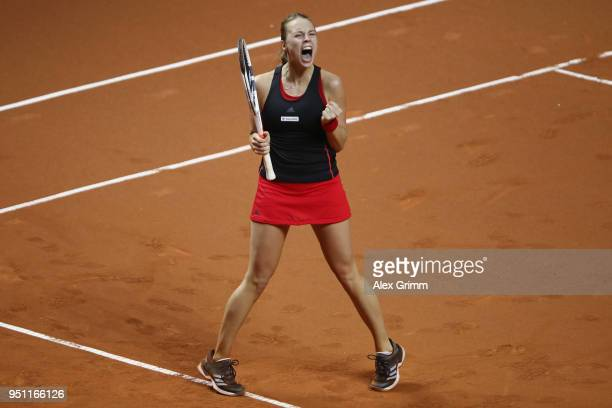 Anett Kontaveit of Estonia celebrates after defeating Kristina Mladenovic of France during day 3 of the Porsche Tennis Grand Prix at Porsche-Arena on...
