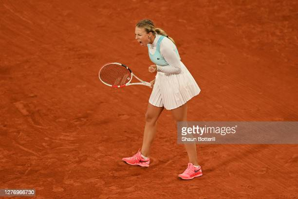 Anett Kontaveit of Estonia celebrates after winning a point during her Women's Singles first round match against Caroline Garcia of France during day...