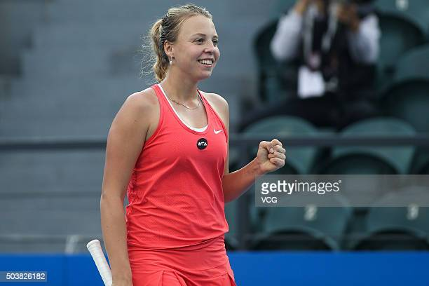 Anett Kontaveit of Estonia celebrates against Zheng Saisai of China in Women's second round match during Day four of 2016 WTA Shenzhen Open at...