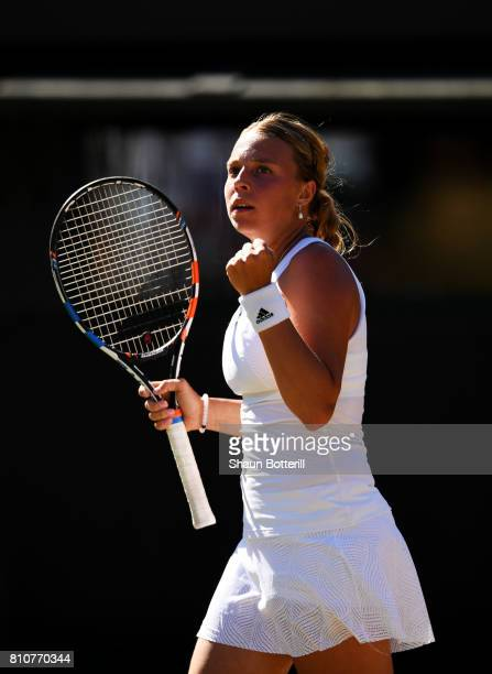 Anett Kontaveit of Estonia celebrates during the Ladies Singles third round match against Caroline Wozniacki of Denmark on day six of the Wimbledon...