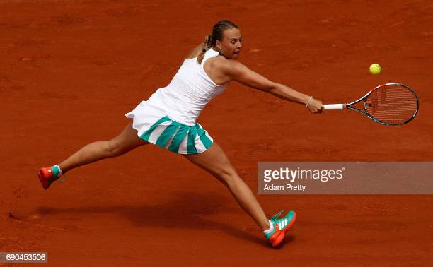 Anett Kontaveit of Estonia hits a backhand during the second round match against Garbine Muguruza of Spain on day four of the 2017 French Open at...